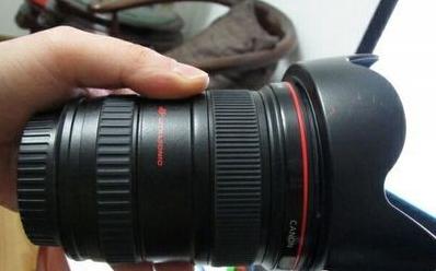 8.5新的佳能17-40F4红圈广角镜头转让。